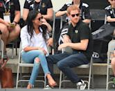 """<p>Just two months before they announced their engagement in 2017, Meghan and Harry were photographed together at The Invictus Games in Canada. We love Meghan's casual look of ripped jeans with a loose Oxford shirt over the top. And her classic <a href=""""https://www.finlayandco.com/blogs/stories/meghan-markle-wearing-percy-sunglasses#:~:text=Meghan%20Markle%20was%20spotted%20out,in%20Toronto%2C%20Canada%20in%202017."""" rel=""""nofollow noopener"""" target=""""_blank"""" data-ylk=""""slk:Finlay London"""" class=""""link rapid-noclick-resp"""">Finlay London</a> sunglasses that promptly sold out...</p>"""