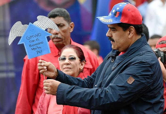 Venezuelan president Nicolas Maduro greets supporters during a march to mark International Workers' Day, in Caracas on May 1, 2016 (AFP Photo/Juan Barreto)