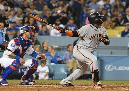 Jun 15, 2018; Los Angeles, CA, USA; San Francisco Giants third baseman Pablo Sandoval (48) hits a two run home run in the seventh inning against the Los Angeles Dodgers at Dodger Stadium. Mandatory Credit: Richard Mackson-USA TODAY Sports