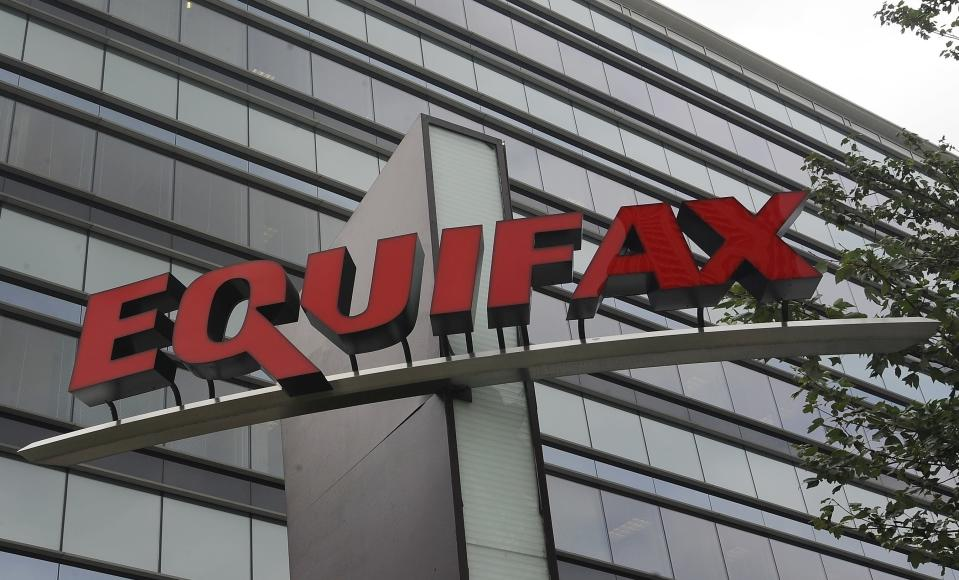 FILE – This July 21, 2012, file photo shows signage at the corporate headquarters of Equifax Inc. in Atlanta. Attacks launched by cybercriminals wreak havoc and cause disruption as more of everyday life moves online. The U.S. attorney's office in Atlanta has worked hand-in-hand with the local FBI office to prosecute a number of high-profile cybercrime cases. They're currently investigating the breach at Atlanta-based Equifax, which exposed the personal information of 145 million Americans. (AP Photo/Mike Stewart, File)