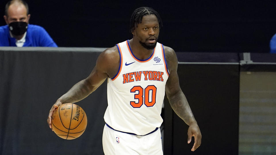 New York Knicks forward Julius Randle dribbles during an NBA basketball game against the Los Angeles Clippers Sunday, May 9, 2021, in Los Angeles. (AP Photo/Marcio Jose Sanchez)