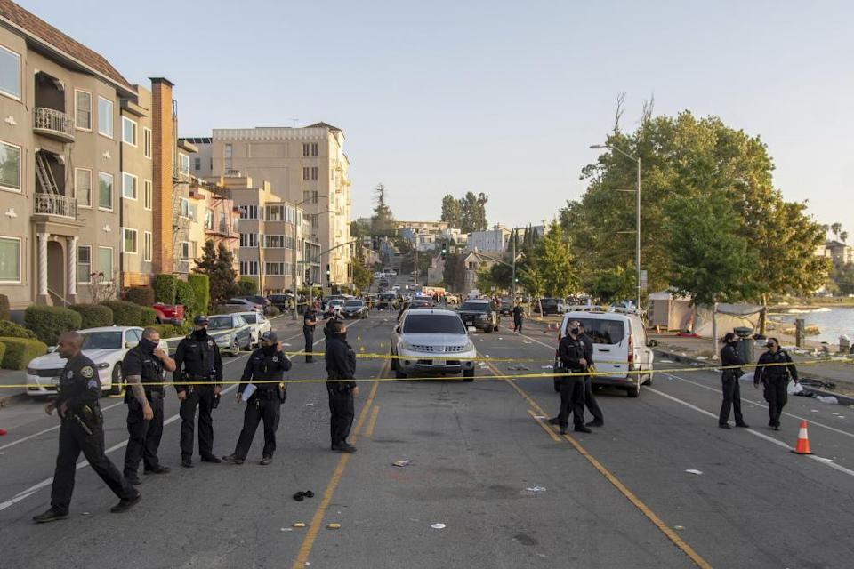 Police officers on the scene at Lake Merritt in Oakland, following a shooting on 19 July.