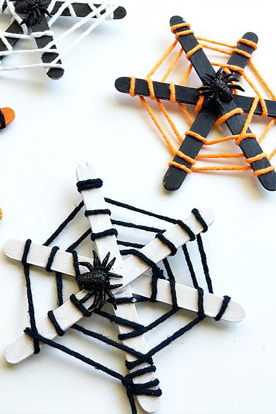 "<p>These not-so-scary spider webs are made with painted crafts sticks and yarn.</p><p><strong>Get the tutorial at Buggy and Buddy.</strong><br></p><p><a class=""link rapid-noclick-resp"" href=""https://www.amazon.com/Acerich-Sticks-Wooden-Popsicle-Length/dp/B01ECBIQAI/?tag=syn-yahoo-20&ascsubtag=%5Bartid%7C10050.g.4950%5Bsrc%7Cyahoo-us"" rel=""nofollow noopener"" target=""_blank"" data-ylk=""slk:SHOP CRAFT STICKS"">SHOP CRAFT STICKS</a></p>"
