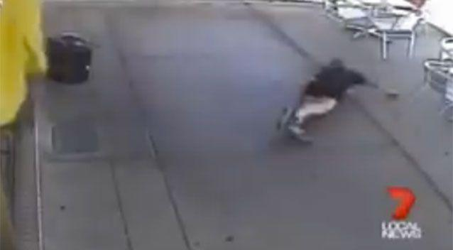 The woman is left on the footpath after the shocking attack. Source: 7 News.