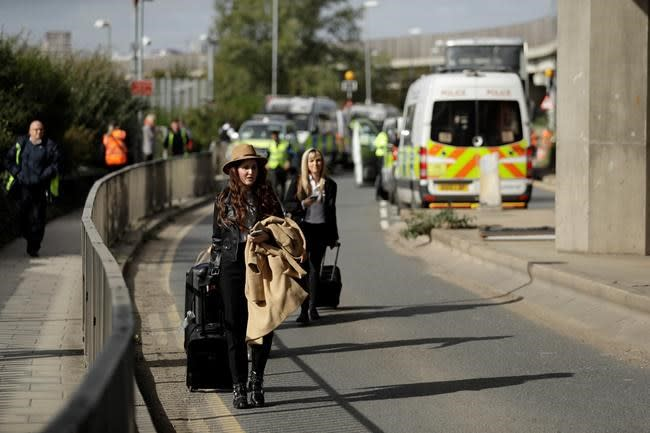 Climate change activist climbs on plane, others stop traffic