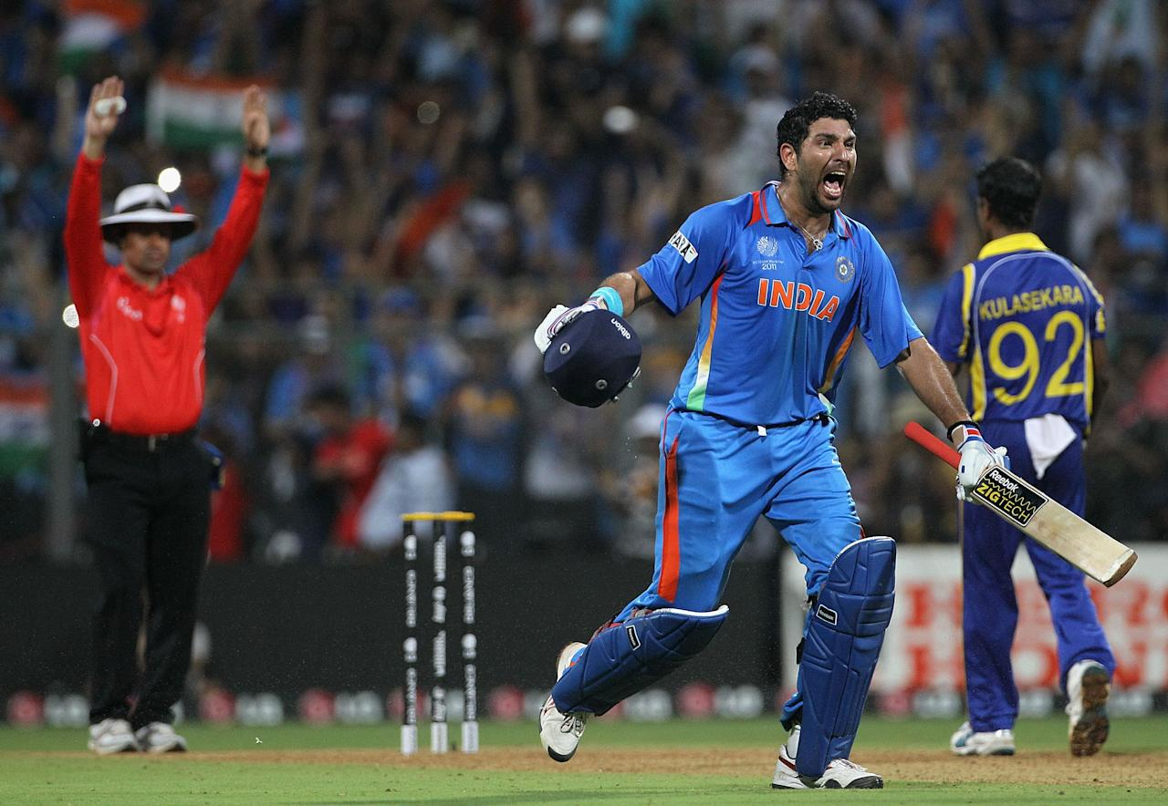 MUMBAI, INDIA - APRIL 02:  Yuvraj Singh of India celebrates after team mate MS Dhoni hit a six to win the match during the 2011 ICC World Cup Final between India and Sri Lanka at Wankhede Stadium on April 2, 2011 in Mumbai, India.  (Photo by Hamish Blair/Getty Images)