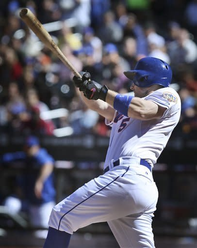 New York Mets' David Wright hits a two-run homer during the first inning of the baseball game against the Miami Marlins Sunday, Sept. 23, 2012 at Citi Field in New York. (AP Photo/Seth Wenig)