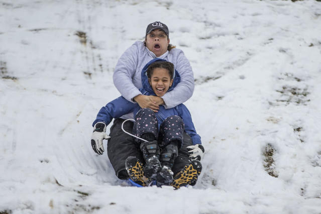 <p>Bridget Mitchell, rear, sleds down the Water Tower hill in Chestnut Hill with her daughter, Olivia Mitchell, 9, in Philadelphia on March 7, 2018. (Photo: Michael Bryant/The Philadelphia Inquirer via AP) </p>