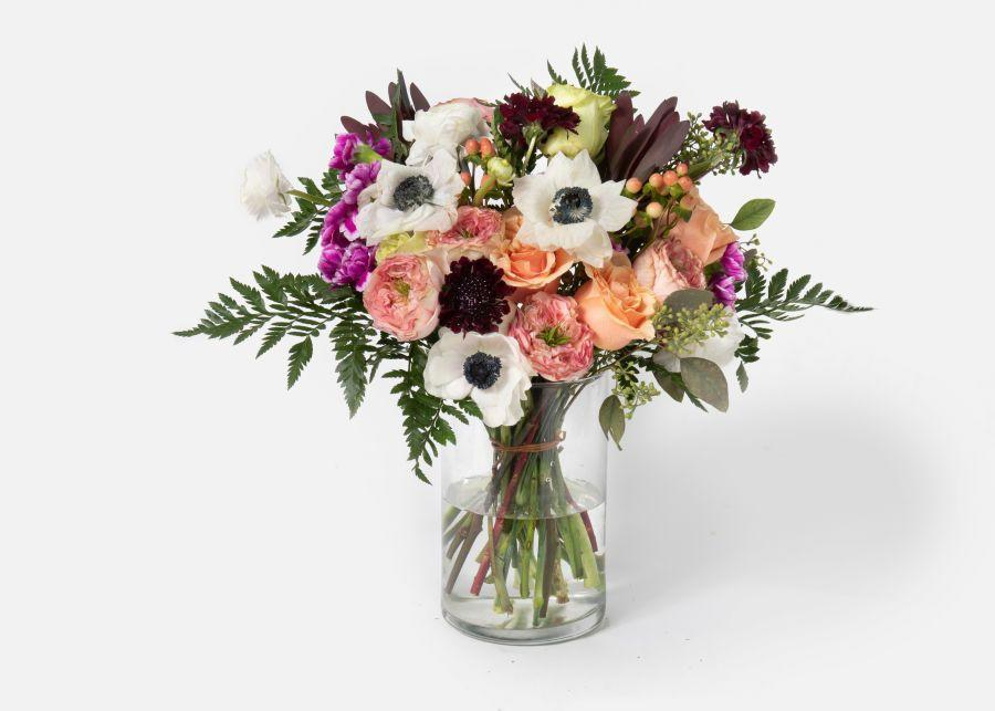 """<p>urbanstems.com</p><p><strong>$130.00</strong></p><p><a href=""""https://go.redirectingat.com?id=74968X1596630&url=https%3A%2F%2Furbanstems.com%2Fproducts%2Fflowers%2Fthe-soiree%2FFLRL-B-00041.html&sref=https%3A%2F%2Fwww.townandcountrymag.com%2Fleisure%2Farts-and-culture%2Fg23837569%2Fthanksgiving-flower-arrangements-ideas%2F"""" rel=""""nofollow noopener"""" target=""""_blank"""" data-ylk=""""slk:Shop Now"""" class=""""link rapid-noclick-resp"""">Shop Now</a></p><p>Play up the greenery and the autumnal color scheme by combining burgundy scabiosa with safari sunset stems and ruffled white and phoenix roses. </p>"""