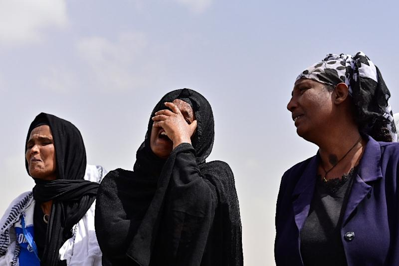 Grief: Relatives arrive at the site (AFP Photo/TONY KARUMBA)