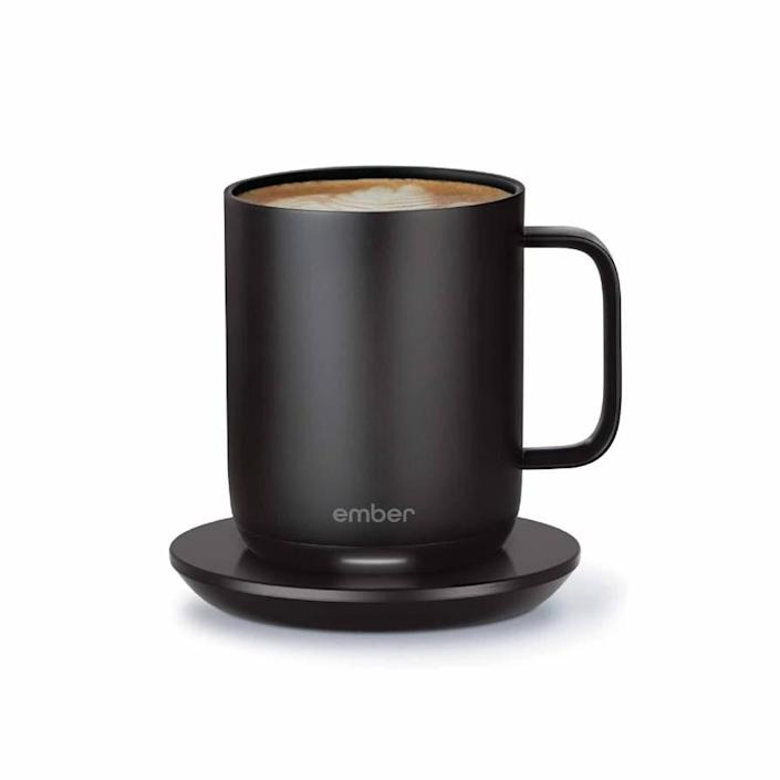 """This <a href=""""https://www.glamour.com/story/shop-the-best-coffee-mugs?mbid=synd_yahoo_rss"""" rel=""""nofollow noopener"""" target=""""_blank"""" data-ylk=""""slk:smart coffee mug"""" class=""""link rapid-noclick-resp"""">smart coffee mug</a> will allow them to set an exact drinking temperature so their coffee is never too hot or too cold. It maintains its temperature for 1.5 hours, cutting down on trips to the microwave for neglected joe. $100, Bloomingdale's. <a href=""""https://www.bloomingdales.com/shop/product/ember-gen-2-mug-10-oz.?ID=3479664"""" rel=""""nofollow noopener"""" target=""""_blank"""" data-ylk=""""slk:Get it now!"""" class=""""link rapid-noclick-resp"""">Get it now!</a>"""