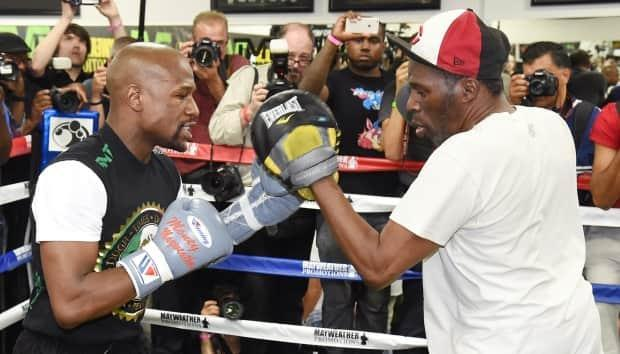 Roger Mayweather, right, trains with nephew Floyd in 2015.