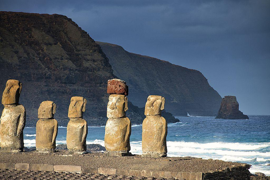 "<strong>Easter Island, Chile</strong><br /><br />Located in the South Pacific more than 2,000 miles off the Chilean coast, Easter Island's not the easiest place to reach. (If you're interested, the easiest access is by air from Santiago or Tahiti.) But isolation has helped preserve the 1,500-year-old mysterious congregation of volcanic rock sculptures (maoi) that's the island's biggest claim to fame. After exploring the unique landscape, relax on an uncrowded beach and ponder one of the most mysterious places on Earth.<br /><br /><a title=""TripAdvisor Plan your holiday"" href=""https://ec.yimg.com/ec?url=http%3a%2f%2fwww.tripadvisor.in%2fTourism-g316040-Easter_Island-Vacations.html%26quot%3b&t=1498307707&sig=93rZJ7cyI9HiVq.wAVC1WA--~C target=""_blank"">Plan your holiday</a> (TripAdvisor)"