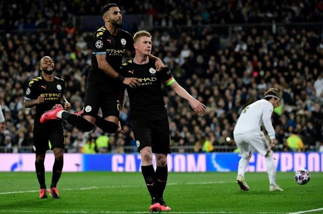 Kevin de Bruyne (right) celebrates scoring a winning penalty as Manchester City beat Real Madrid 2-1 on Wednesday at the Santiago Bernabeu. (AFP Photo/JAVIER SORIANO)