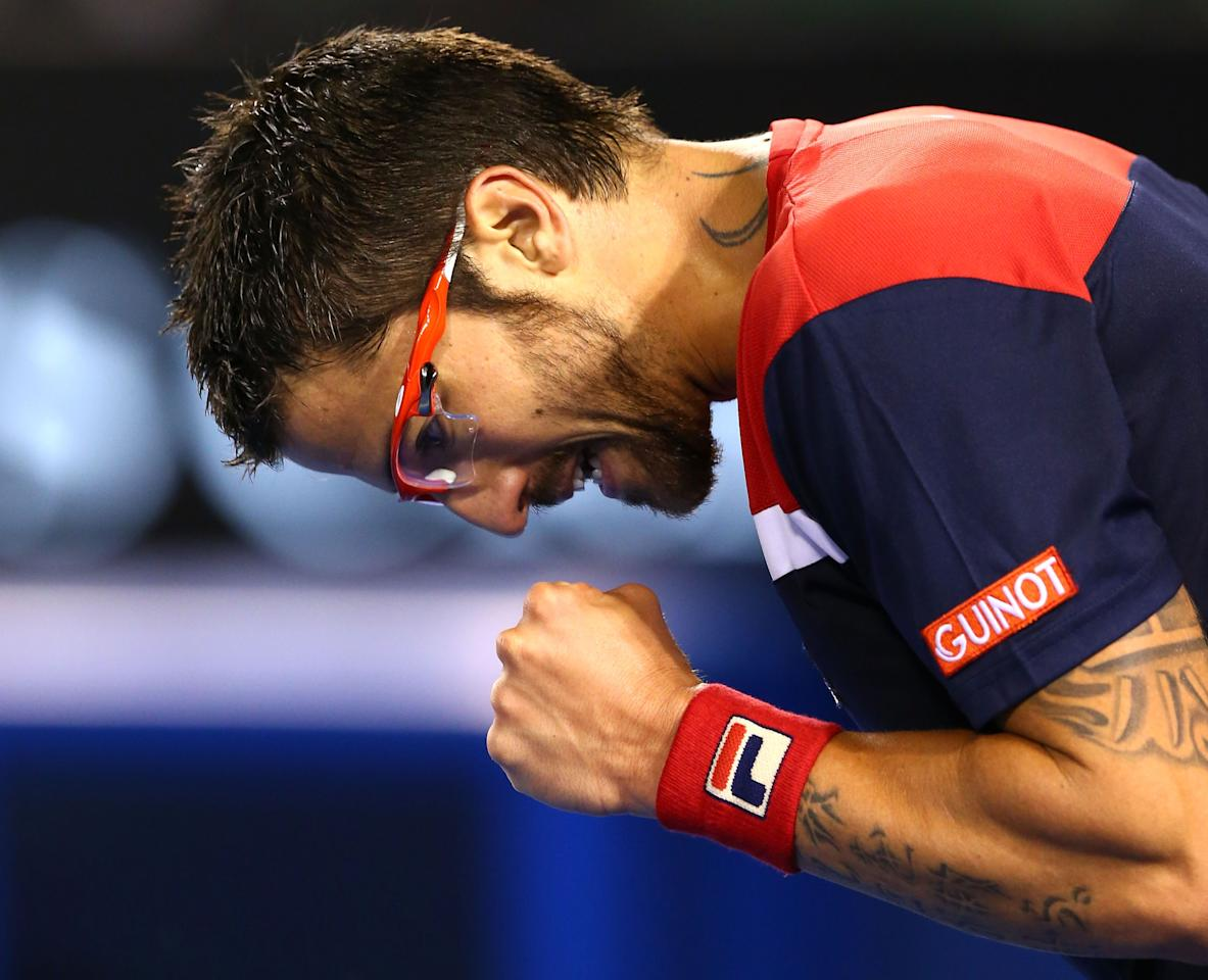 MELBOURNE, AUSTRALIA - JANUARY 14:  Janko Tipsarevic of Serbia celebrates winning a point in his first round match against Lleyton Hewitt of Australia during day one of the 2013 Australian Open at Melbourne Park on January 14, 2013 in Melbourne, Australia.  (Photo by Ryan Pierse/Getty Images)