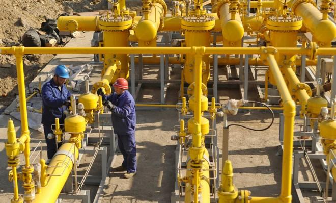 Employees install equipment at a natural gas plant in Liaoning province, China.