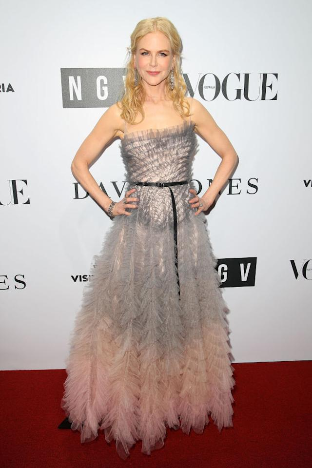 <p>Nicole chose a feathery Dior gown that went from a gorgeous gray to the palest of pinks.<br /><em>[Photo: Getty]</em> </p>