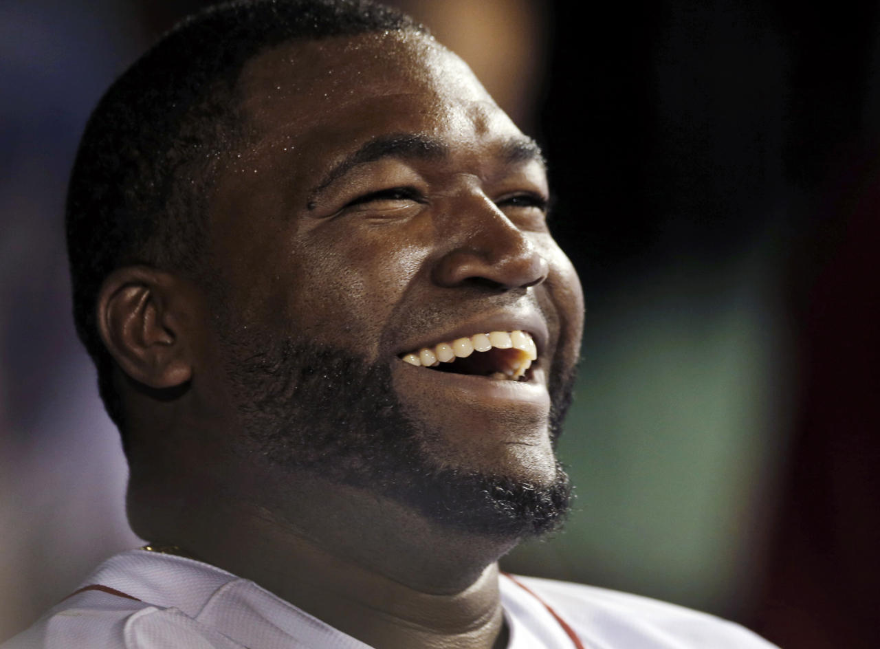 "FILE - In this Sept. 4, 2013, file photo, Boston Red Sox designated hitter David Ortiz laughs with teammates in the dugout after hitting a double for his 2,000th career hit, in the sixth inning of a baseball game against the Detroit Tigers at Fenway Park in Boston. The Red Sox prepare to honor Ortiz, retiring the No. 34 worn by ""Big Papi"" when he led the once-cursed franchise to three World Series titles. The ceremony is Friday night, June 23, 2017. (AP Photo/Elise Amendola, File)"