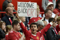 A fan holds up a sign for Manchester United's Cristiano Ronaldo during the players' warmup before the English Premier League soccer match between Manchester United and Newcastle United at Old Trafford stadium in Manchester, England, Saturday, Sept. 11, 2021. (AP Photo/Rui Vieira)