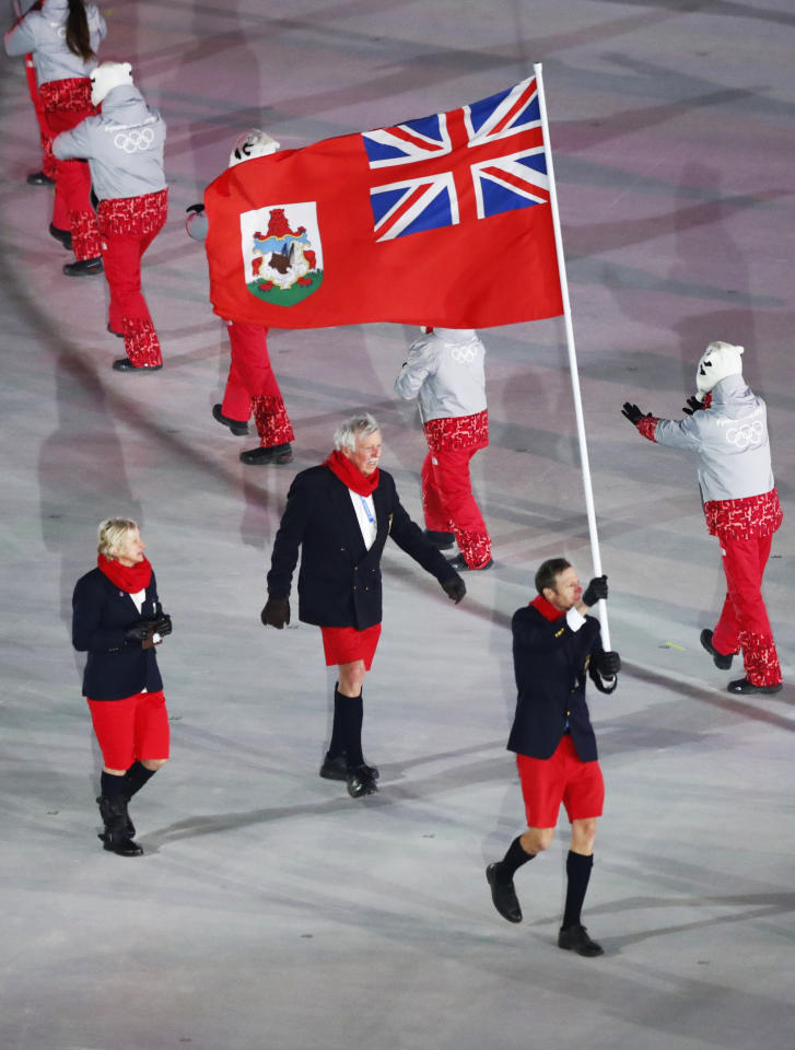 <p>Tucker Murphy carries the flag of Bermuda during the opening ceremony of the 2018 Winter Olympics in Pyeongchang, South Korea, Friday, Feb. 9, 2018. (AP Photo/Matthias Schrader) </p>