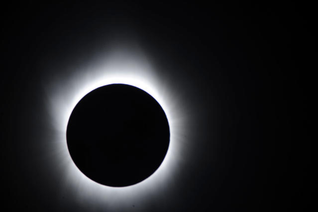 TOKYO - JULY 22: In this handout image provided by National Astronomical Observatory of Japan and transmitted with the help of NICT and JAXA, the solar eclipse is seen on July 22, 2009 in Iwojima Island, Tokyo, Japan. The longest total eclipse of the sun of this century triggered tourist fever in Asia as astronomy enthusiasts from home and abroad flocked to watch the event The eclipse was visible from within a narrow corridor that begins in India and crosses through Nepal, Bangladesh, Bhutan, Myanmar and China. (Photo by National Astronomical Observatory of Japan via Getty Images)