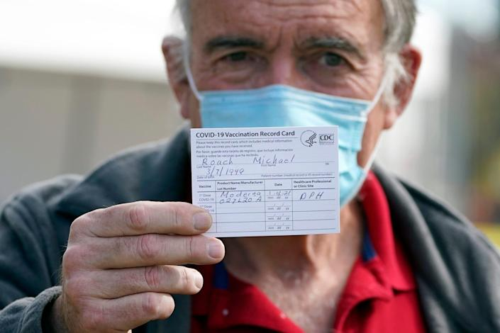 Dr. Michael Roche showed his vaccination card Wednesday after receiving Moderna COVID-19 vaccine at a facility for health care workers in Pacoima, Calif.