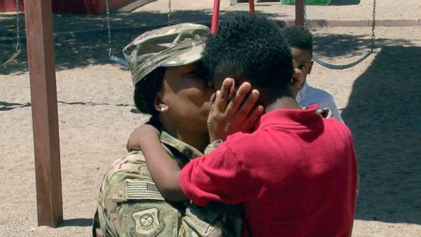 PHOTO: Shania Porter embraces her son Bryce, 5, Crown Charter School in Maricopa County, Arizona, on the afternoon of Aug. 7. (KNXV)