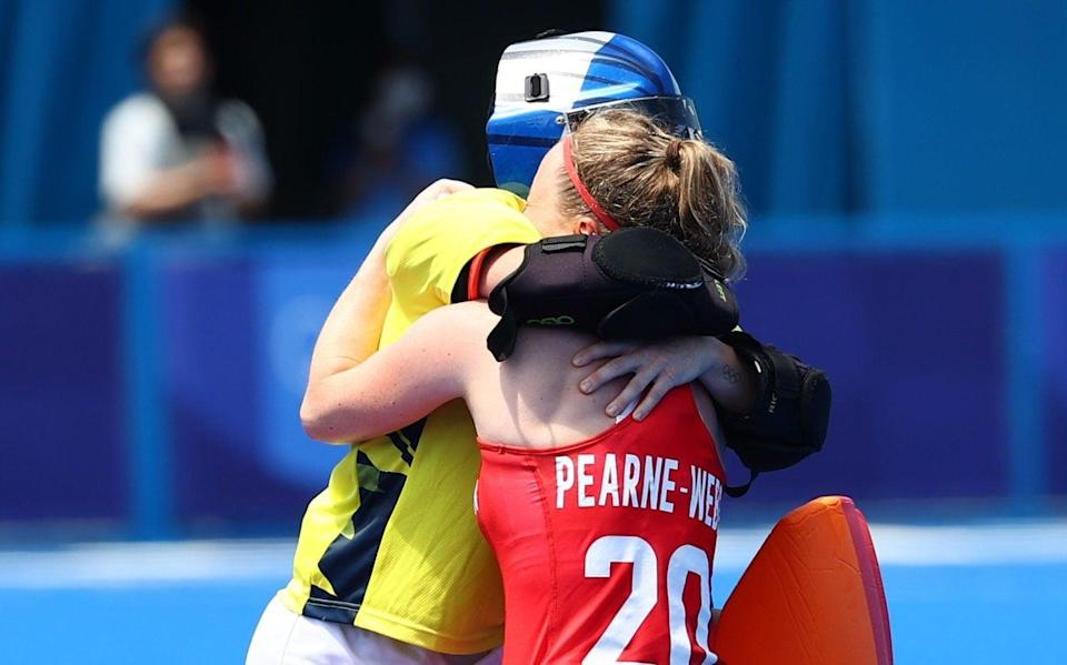 Hollie Pearne-Webb and Maddie Hinch embrace after the match - the pair were crucial members of the gold medal-inning side in Rio and their experience proved key in Tokyo - REUTERS
