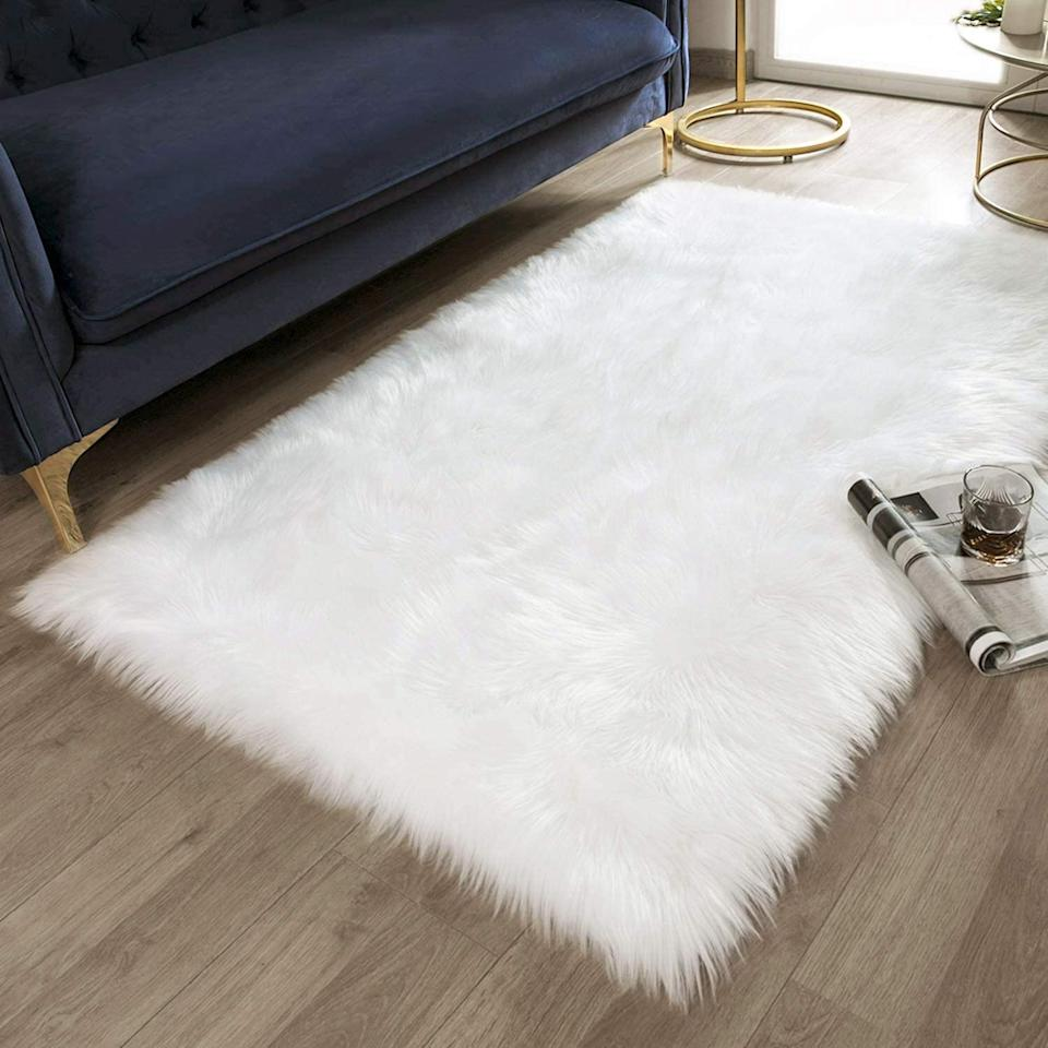 """<h2><a href=""""https://www.amazon.com/dp/B07H87HZ67/ref=sspa_dk_detail_8?"""" rel=""""nofollow noopener"""" target=""""_blank"""" data-ylk=""""slk:Ashler Soft Faux Fur Area Rug"""" class=""""link rapid-noclick-resp"""">Ashler Soft Faux Fur Area Rug</a></h2>Soft to the touch, and luxurious-looking, this soft faux fur area rug is an easy way to make your living space look glamorous. The best part? It costs less than $50. <br><br><strong>Ashler Home Deco</strong> Ashler Soft Faux Fur Area Rug, $, available at <a href=""""https://www.amazon.com/dp/B07H87HZ67/ref=sspa_dk_detail_8?"""" rel=""""nofollow noopener"""" target=""""_blank"""" data-ylk=""""slk:Amazon"""" class=""""link rapid-noclick-resp"""">Amazon</a>"""