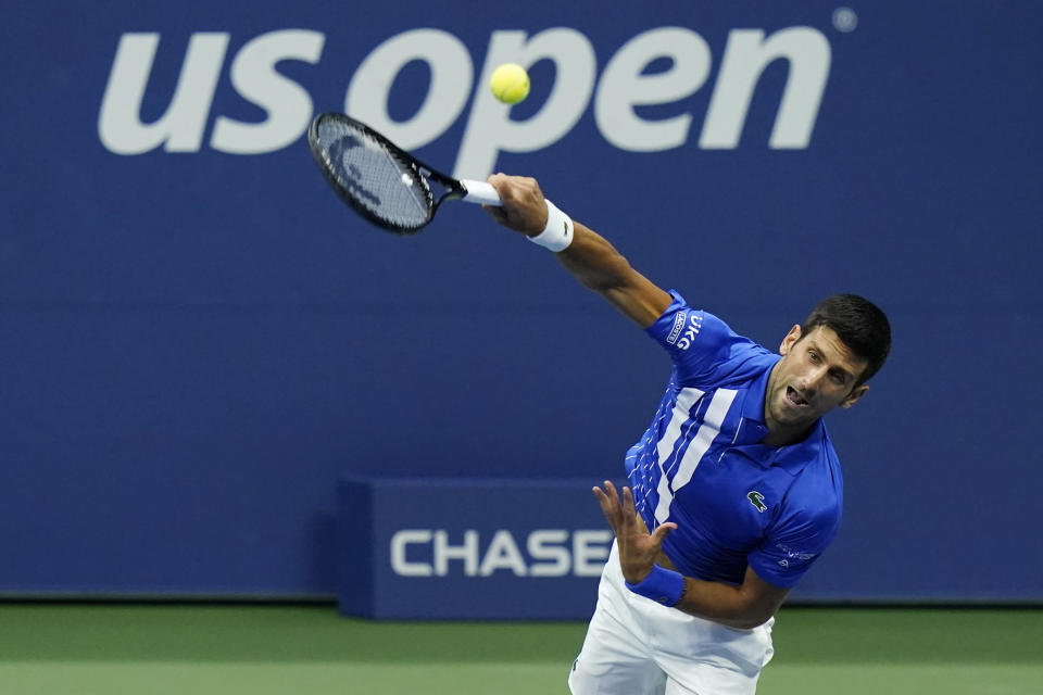 FILE - Novak Djokovic, of Serbia, serves to Jan-Lennard Struff, of Germany, during the third round of the U.S. Open tennis championships in New York, in this Friday, Sept. 4, 2020, file photo. Djokovic will begin his bid to win the U.S. Open for a men's-record 21st major tennis championship and to complete a calendar-year Grand Slam by facing a player who comes through qualifying. (AP Photo/Frank Franklin II, File)
