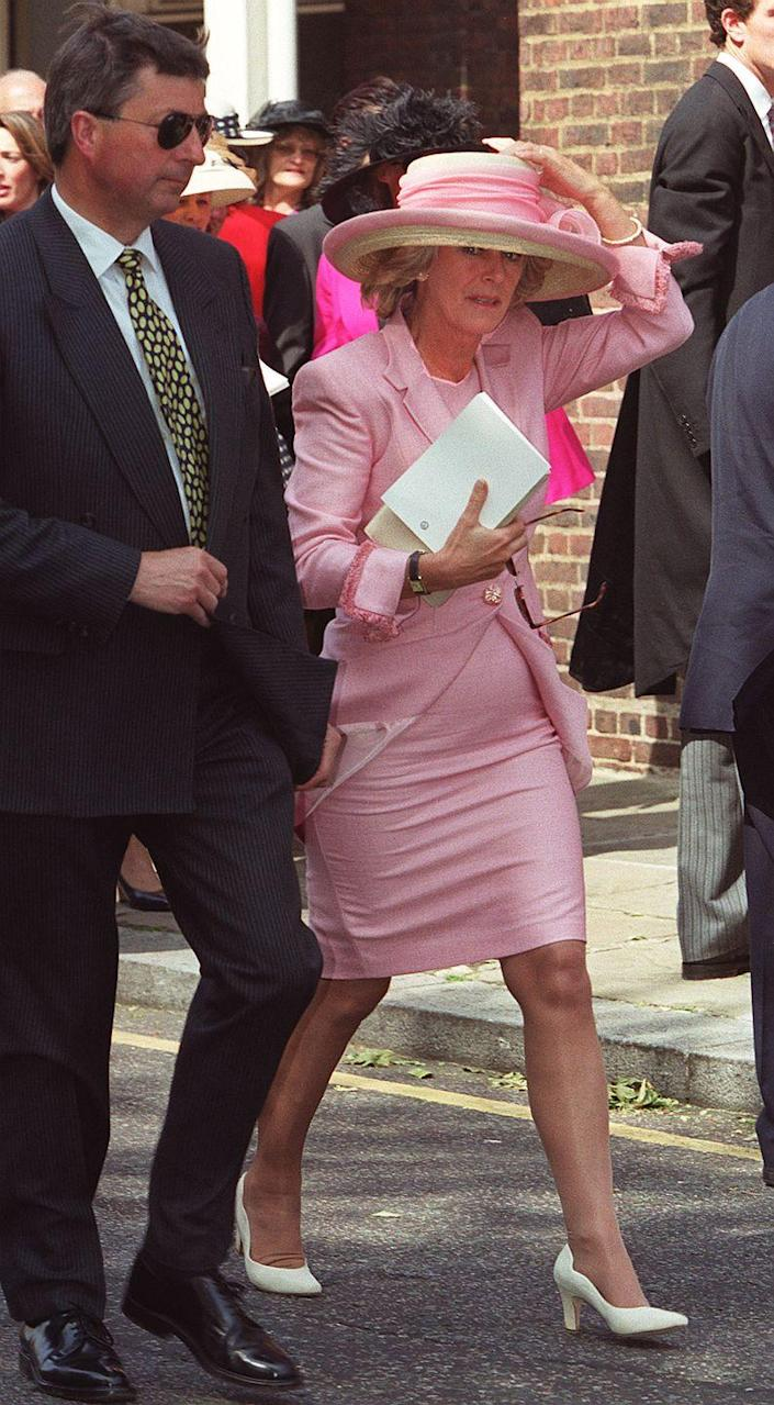 <p>For the wedding of Samantha Shaw & David Keswick in London, Camilla donned a pink sheath dress with matching dress coat with fringed cuffs. </p>