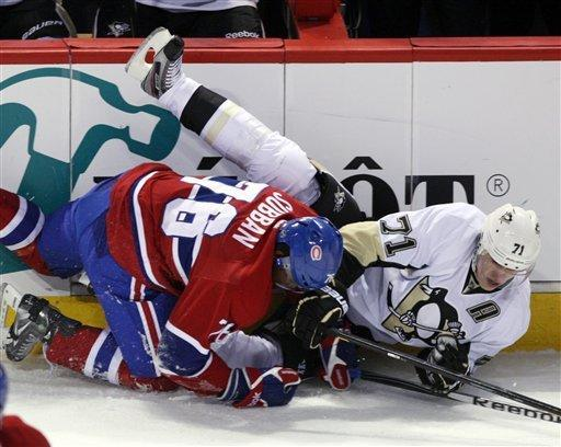 Montreal Canadiens defenseman P.K. Subban (76) checks Pittsburgh Penguins center Evgeni Malkin (71) to the ice during the first period of an NHL hockey game Tuesday, Feb. 7, 2012, in Montreal. (AP Photo/The Canadian Press, Ryan Remiorz)
