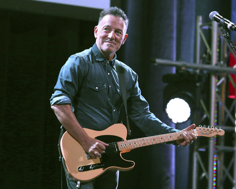 """FILE - In this Nov. 1, 2016 file photo, Bruce Springsteen performs at Stand Up For Heroes in New York. Springsteen will return to Broadway this summer for a limited run of his one-man show """"Springsteen on Broadway."""" Performances at the St. James Theatre begin June 26 with an end date set for Sept. 4. (Photo by Greg Allen/Invision/AP, File)"""