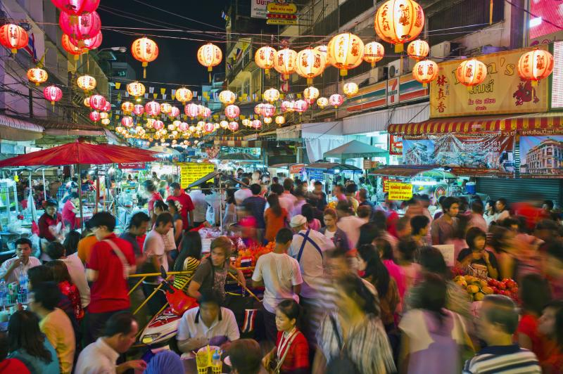 Thailand, Bangkok, China town during Chinese New Year, busy night market, crowds of people shopping.