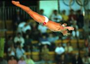 FILE - In this Sept. 26, 1988, file photo, Greg Louganis, of the United States,, performs in the men's preliminary 10-meter platform diving competition at the XXIV Summer Olympic Games in Seoul, South Korea. As an athlete mentor at the London Olympics, Louganis is trying to make sure the stress of winning medals isn't heaped on the shoulders of American divers, who have been chasing his standard of excellence since Louganis became the sport's icon in the 1980s. The U.S. has been blanked in diving in two consecutive Olympics, and hasn't won a gold since 2000. (AP Photo/Ed Reinke, File)