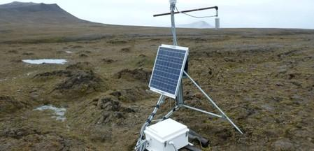 Solar-powered scientific equipment records data in a landscape of partially thawed Arctic permafrost near Isachsen