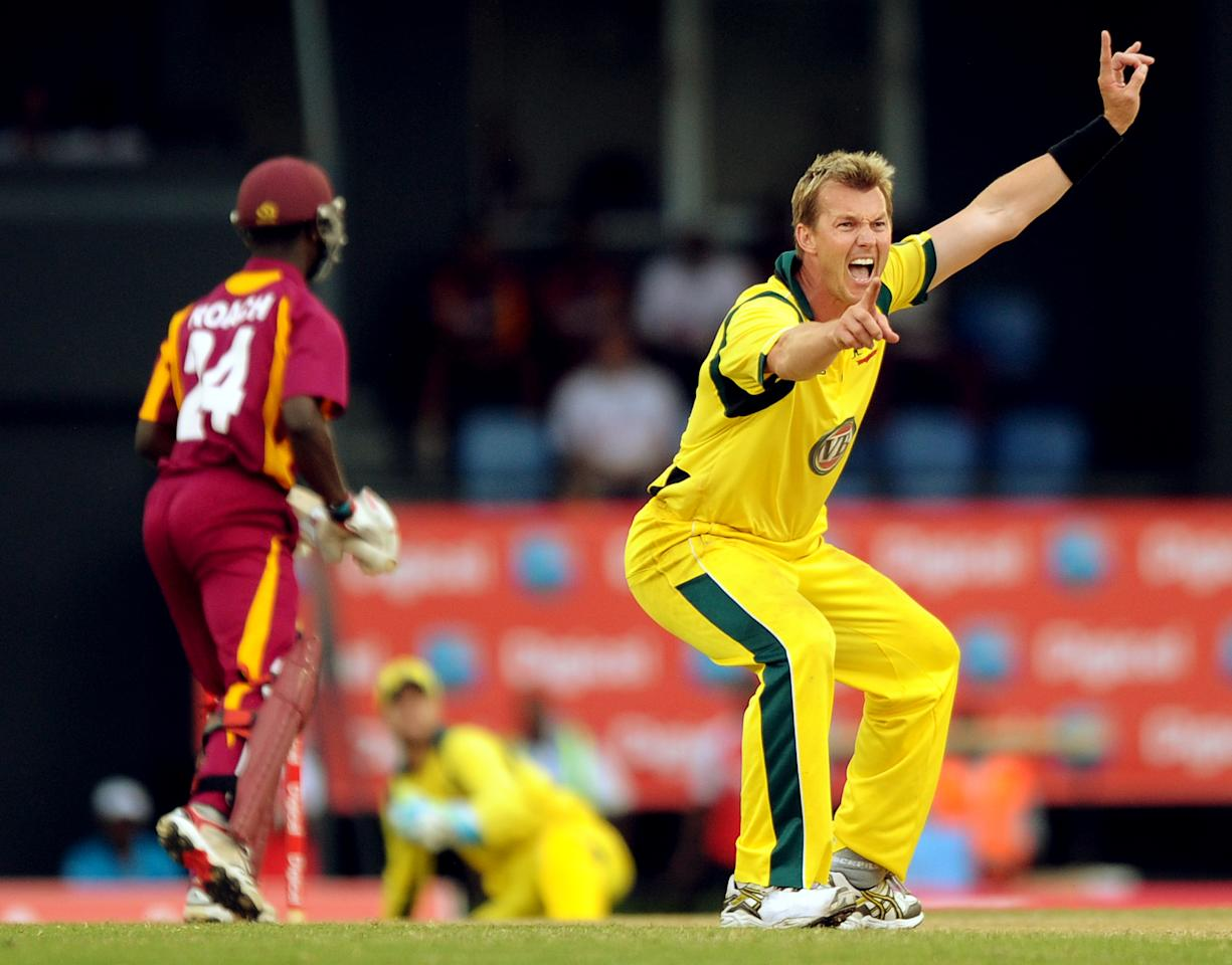 Australian cricketer Brett Lee (R) appeals to the referee after bowling to Wes tIndies batsman Kemar Roach during the fifth-of-five One Day International (ODI) matches between West Indies and Australia at the Beausejour Cricket Ground in Gros Islet, St. Lucia on March 25, 2012.     AFP PHOTO/Jim Watson (Photo credit should read JIM WATSON/AFP/Getty Images)