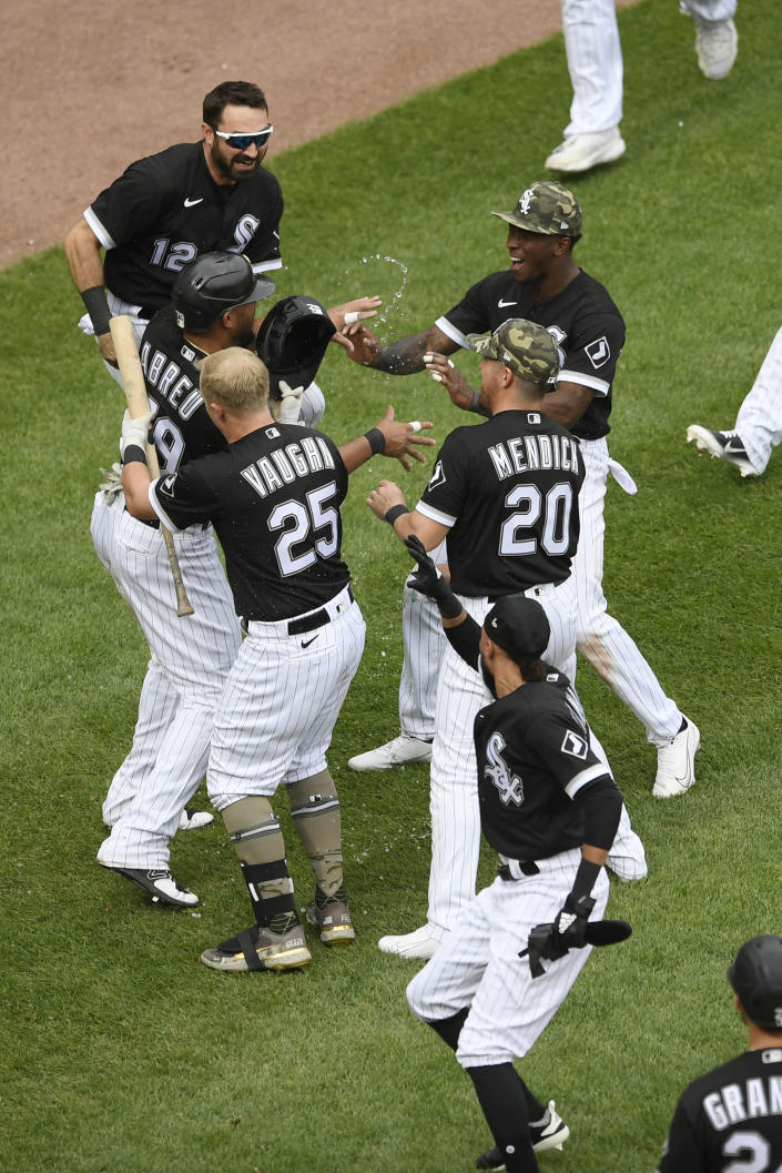 Chicago White Sox's Jose Abreu (79) celebrates with teammates after sliding into home plate safely on a wild pitch to defeat the Kansas City Royals in a baseball game Sunday, May 16, 2021, in Chicago. (AP Photo/Paul Beaty)