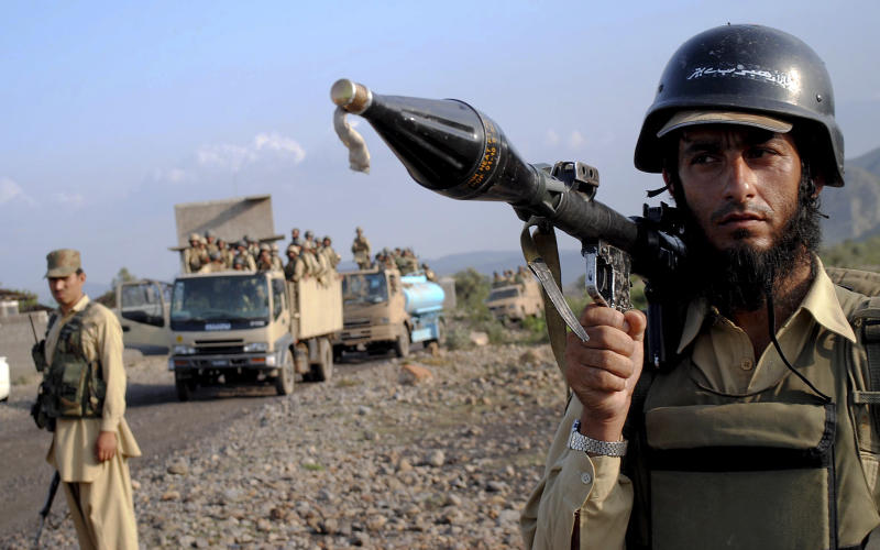 "A Pakistani paramilitary soldier secure an area as other troops move toward a forward base during a military operation against militants in Pakistan's Khurram tribal region, Saturday, July 9, 2011.  ""A military operation in Kurram tribal region has been launched to clear the area of terrorists involved in all kinds of terrorist activities, including kidnapping and killing of locals, suicide attacks and blocking the road connecting Lower with upper Kurram,"" Pakistani army spokesman Maj. Gen. Athar Abbas  said. (AP Photo/Mohammad Zubair)"