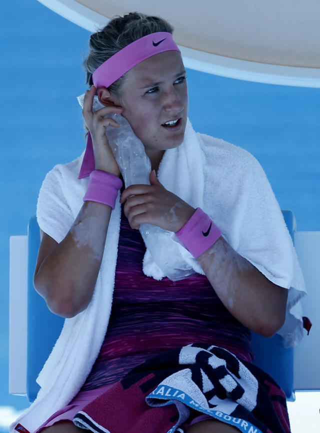 Victoria Azarenka of Belarus holds an ice pack to her face during a break in her first round match against Johanna Larsson of Sweden at the Australian Open tennis championship in Melbourne, Australia, Tuesday, Jan. 14, 2014.(AP Photo/Eugene Hoshiko)