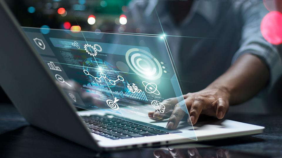 Data scientists. Male programmer using laptop analyzing and developing in various information on futuristic virtual interface screen. Algorithm. marketing and deep learning of artificial intelligence