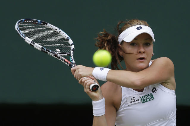 Agnieszka Radwanska of Poland plays a shot to Angelique Kerber of Germany during a semifinals match at the All England Lawn Tennis Championships at Wimbledon, England, Thursday, July 5, 2012. (AP Photo/Alastair Grant)