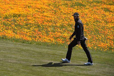 Feb 10, 2018; Pebble Beach, CA, USA; Dustin Johnson walks the eighth fairway during the third round of the AT&T Pebble Beach Pro-Am golf tournament at Pebble Beach Golf Links. Mandatory Credit: Orlando Ramirez-USA TODAY Sports