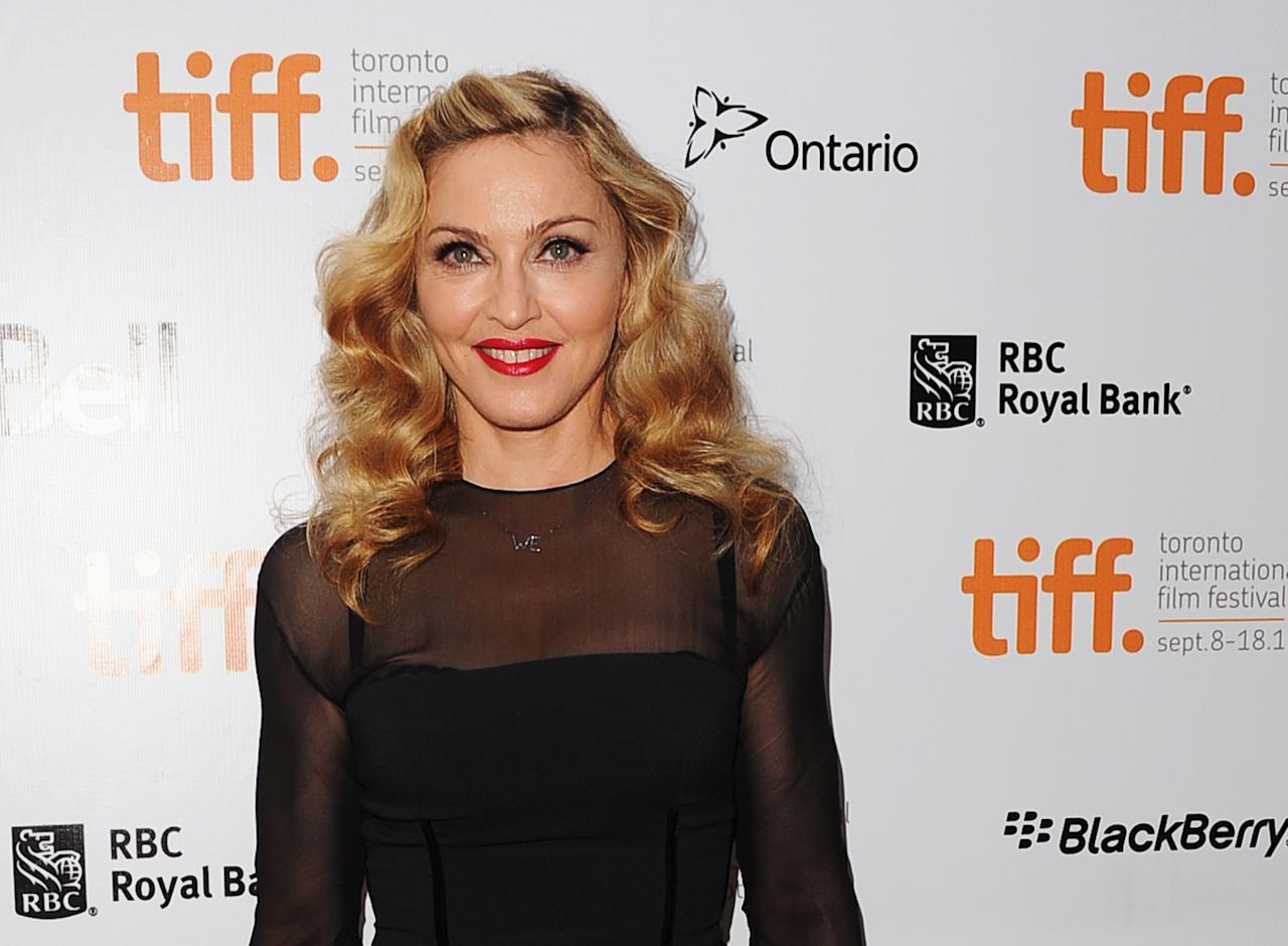 "TORONTO, ON - SEPTEMBER 12:  Director Madonna arrives at ""W.E"" Premiere at Roy Thomson Hall during the 2011 Toronto International Film Festival on September 12, 2011 in Toronto, Canada.  (Photo by Jason Merritt/Getty Images)"