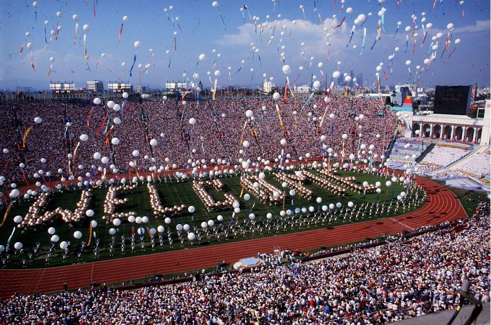 """<p>There was a lot of anticipation building up to the opening of the 1984 Summer Olympics. A countdown clock in the stadium marked the exact start, with cannons and church bells ringing throughout the city the exact moment the ceremonies started. Then, over 1,000 volunteers gathered in formation to spell out """"Welcome,"""" which was also the name of the song created just for the 1984 Summer Olympics. After that, """"Rocket Man"""" Bill Suitor traveled through the stadium with a jet pack while a skywriter spelled out another """"Welcome"""" overhead. </p>"""