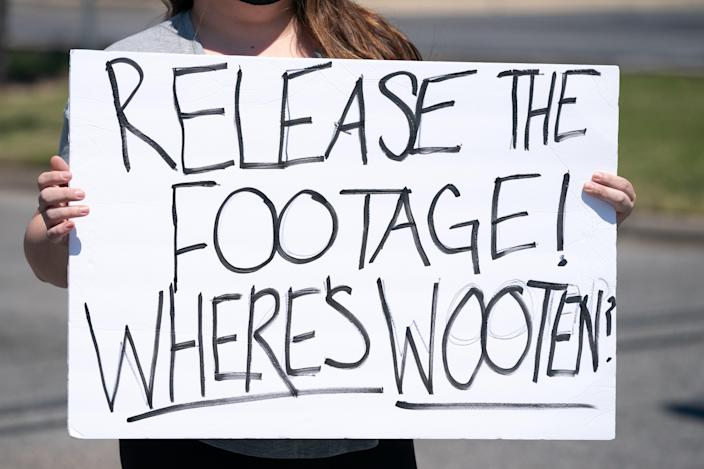 <p>ELIZABETH CITY, NC - APRIL 23: A demonstrator holds a sign addressing Pasquotank County Sheriff Tommy Wooten after an emergency city council meeting April 23, 2021 in Elizabeth City, North Carolina. Protestors were calling for the release of police body camera footage from the shooting death of Andrew Brown Jr. on April 21. </p> ((Photo by Sean Rayford/Getty Images))