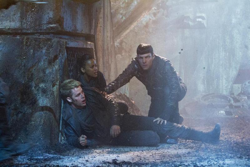 "This undated publicity film image released by Paramount Pictures shows Chris Pine as Kirk, Zoe Saldana as Uhura and Zachary Quinto as Spock in a scene from the movie, ""Star Trek Into Darkness,"" from Paramount Pictures and Skydance Productions. (AP Photo/Paramount Pictures, Zade Rosenthal)"