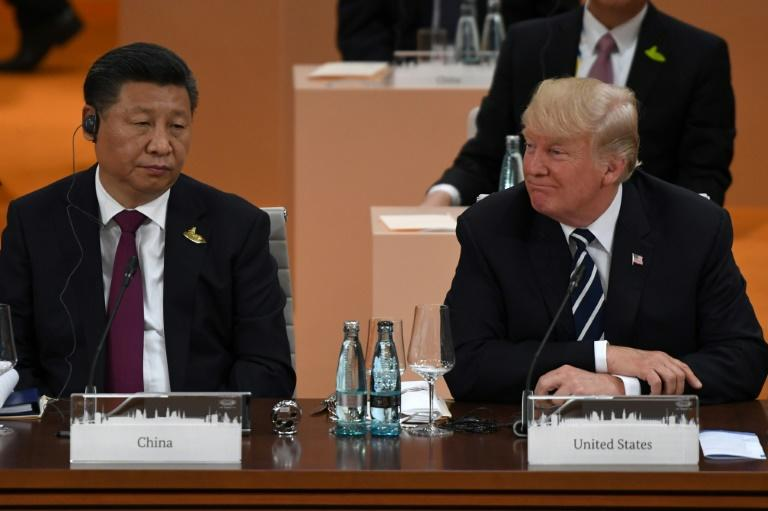 China's President Xi Jinping (L) and US President Donald Trump attend a working session on the first day of the G20 summit in Hamburg on July 7, 2017