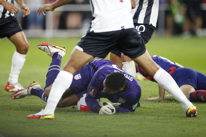 United States' Zack Steffen dives on a ball to make a save against Costa Rica during the second half of a World Cup qualifying soccer match Wednesday, Oct. 13, 2021, in Columbus, Ohio. The United States won 2-1. (AP Photo/Jay LaPrete)