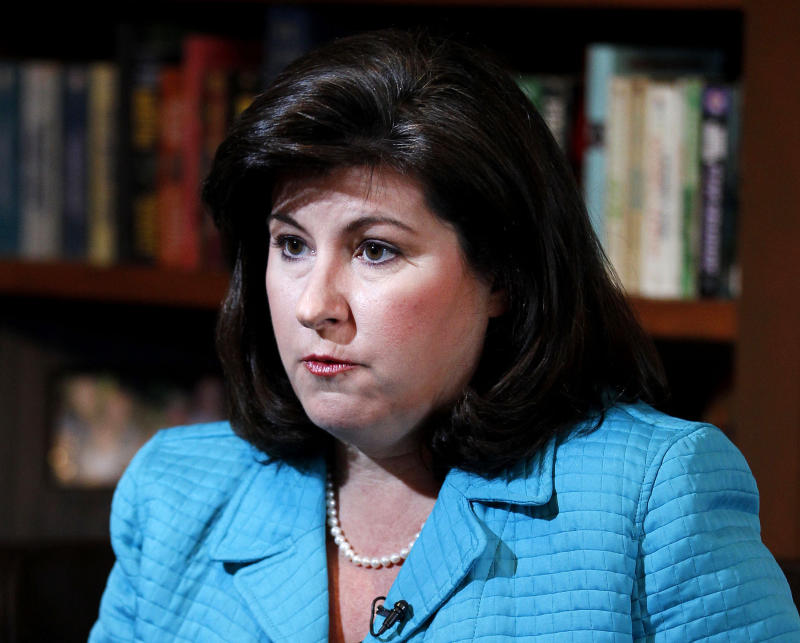 """FILE - This Feb. 7, 2012 file photo shows Karen Handel, former ice president for public policy for Susan G. Komen for the Cure breast-cancer charity, speaking during an interview in Atlanta.   Handel, the former Susan G. Komen executive at the heart of the organization's clash with Planned Parenthood has a book deal. Howard Books, an imprint of Simon & Schuster, announced Monday, Aug. 13, that Karen Handel's """"Planned Bullyhood"""" will come out Sept. 11. (AP Photo/John Bazemore, file)"""